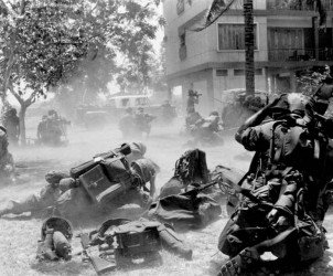 In this April 13, 1975, file photo, U.S. Marines come under Khmer Rouge fire while they were on the ground near the U.S. embassy during Operation Eagle Pull which evacuated American and embassy personnel in Phnom Penh, Cambodia. Five days after Operation Eagle Pull, the dramatic evacuation of Americans, the U.S.-backed government fell as communist Khmer Rouge guerrillas stormed into Phnom Penh. Nearly 2 million Cambodians - one in every four - would die from executions, starvation and hideous torture. (AP Photo/Tea Kim Heang, File)